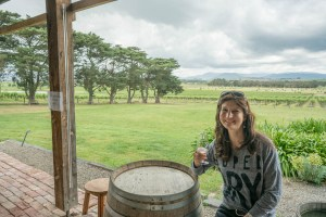 Ilinca with one of her many wines near Melbourne
