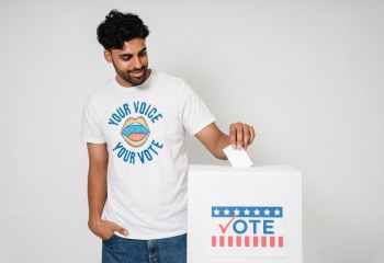 photo of man putting his vote on the white box
