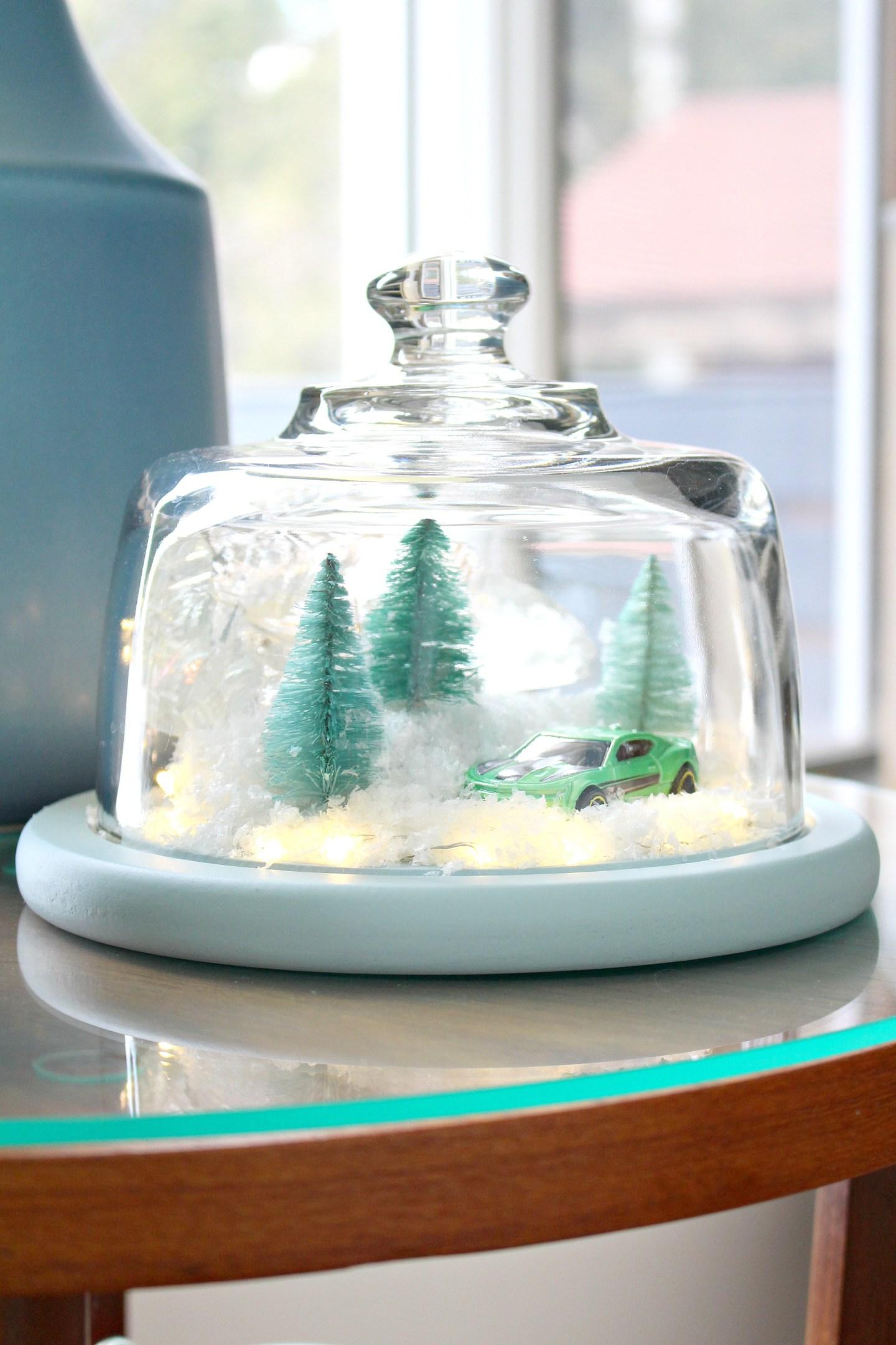 DIY Winter Diorama | aka The Camaro Cloche. Make this easy winter decor using a thrifted cheese cloche. Camaro themed holiday decor, lol! #diy #holidaydecor