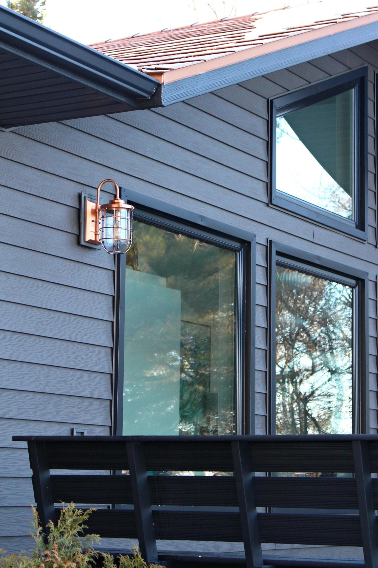 Copper Ferry Lights on Dark Grey Metal Siding with Copper Roof | Siding That Sparkles!