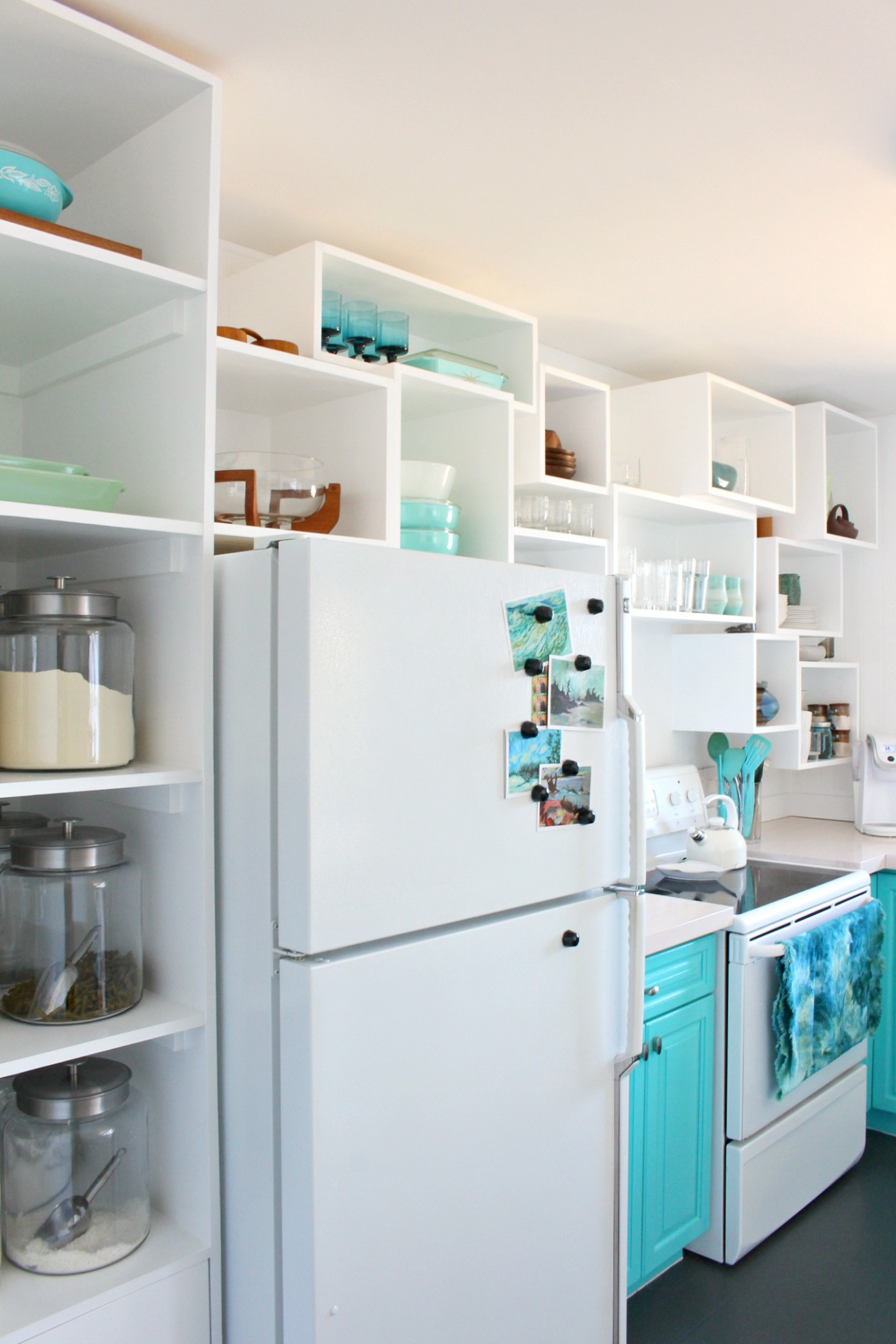 How to Build Wall Cubbies   Fresh Take on Kitchen Open Shelving in Bold Turquoise Kitchen