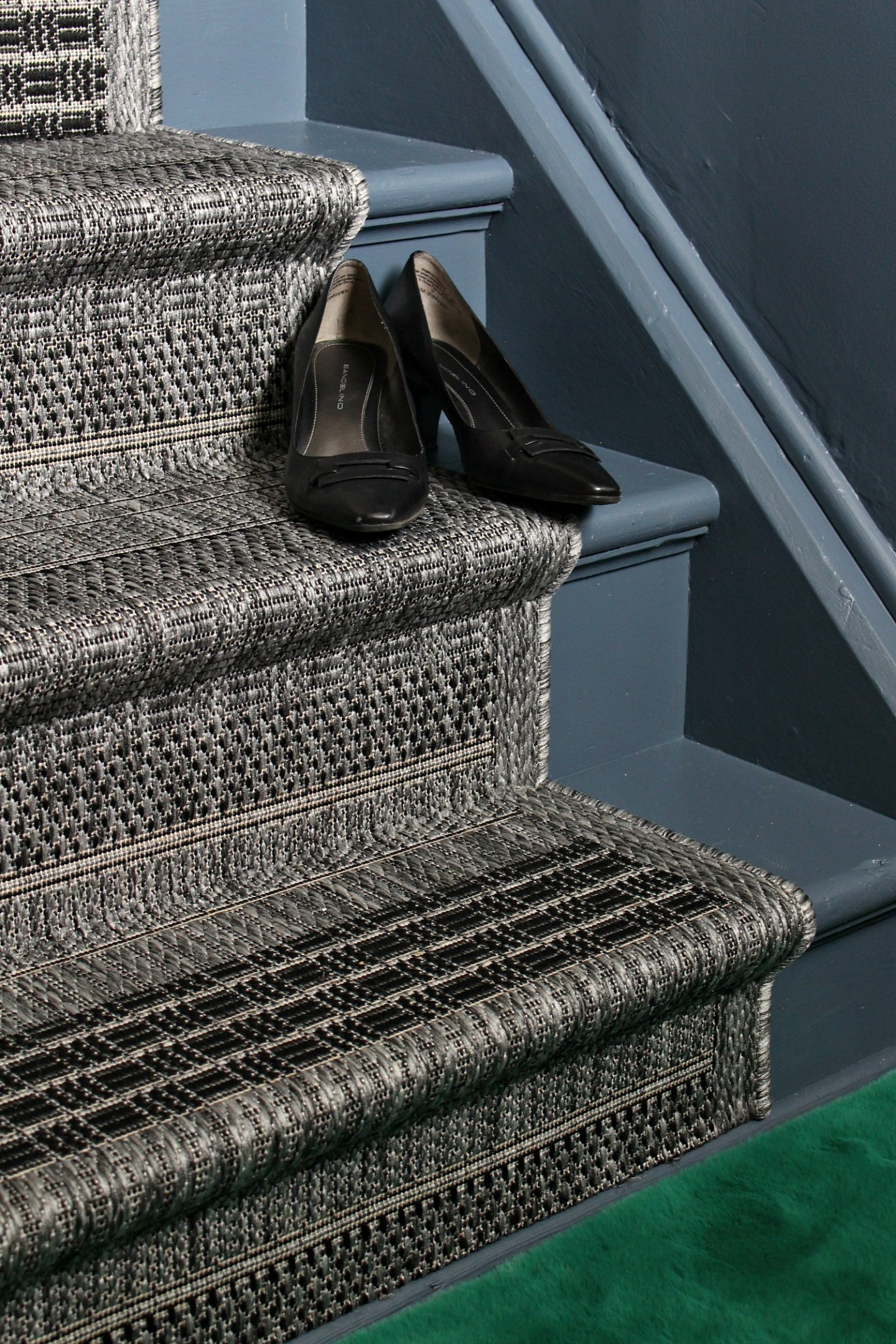 grey painted stairs and grey and white runner