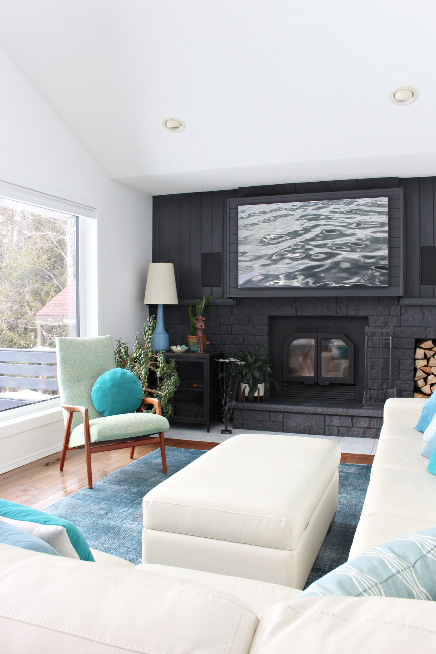 Black Fireplace with Cream Sofa and Teal Accents