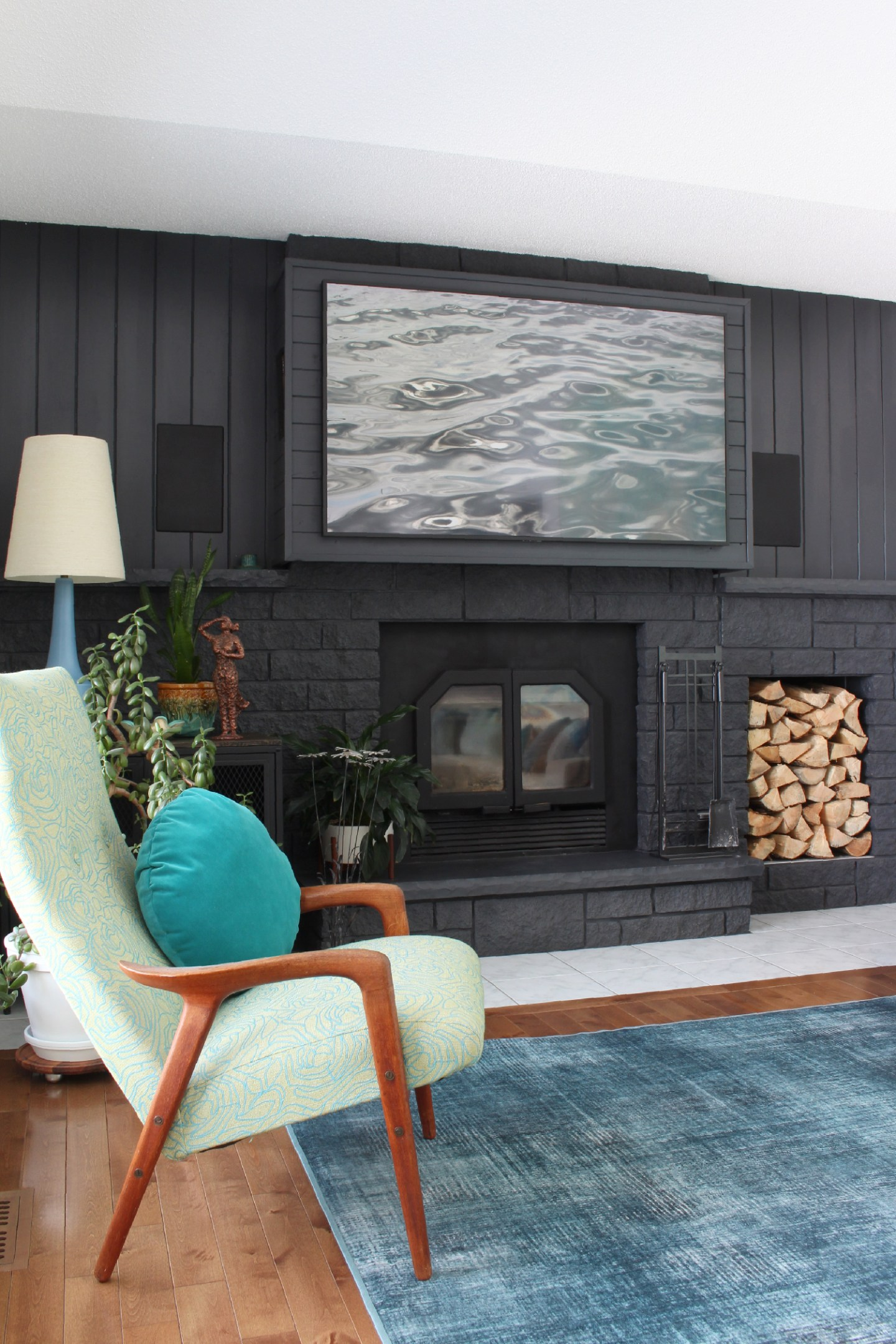 Black Fireplace with Pops of Teal and Mint Green