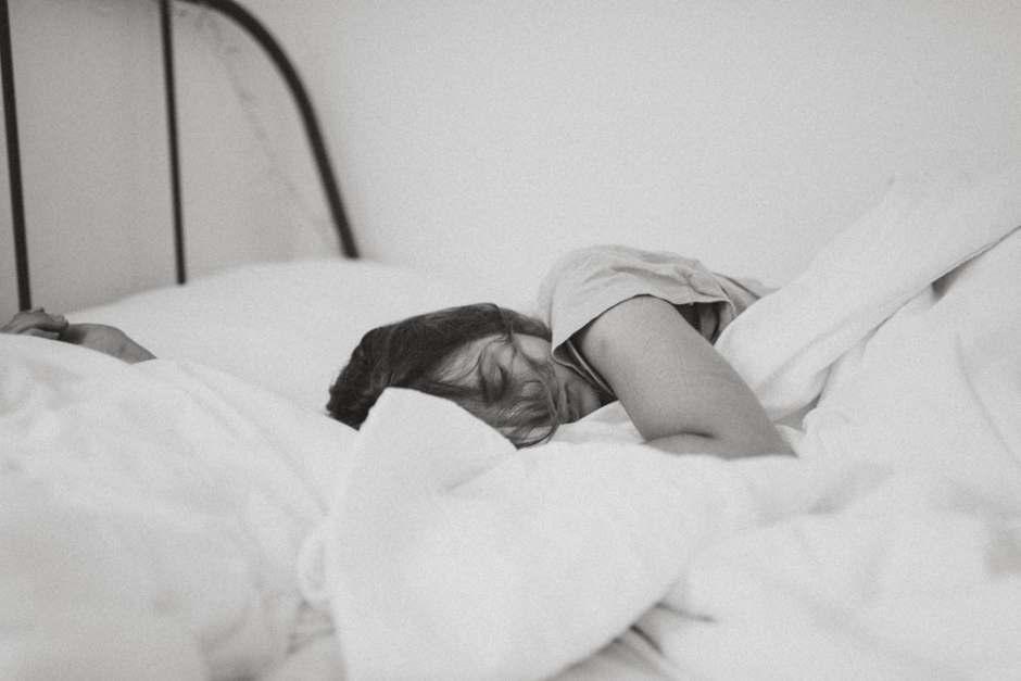 leeping woman lying on bed
