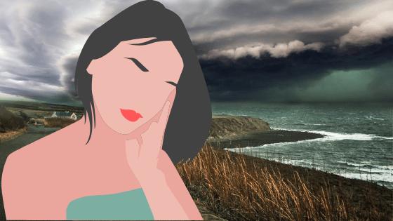 morskie wybrzerze i zastanawiająca się kobieta