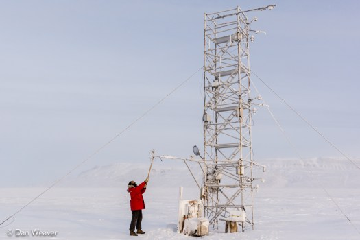 PEARL technician cleans wind instruments at the flux tower