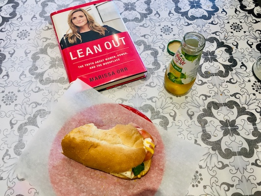 Marissa Orr's book Lean Out rests on a table beside a ham sandwich