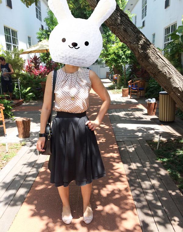 Coco-wearing-polka-dots-black-skirt
