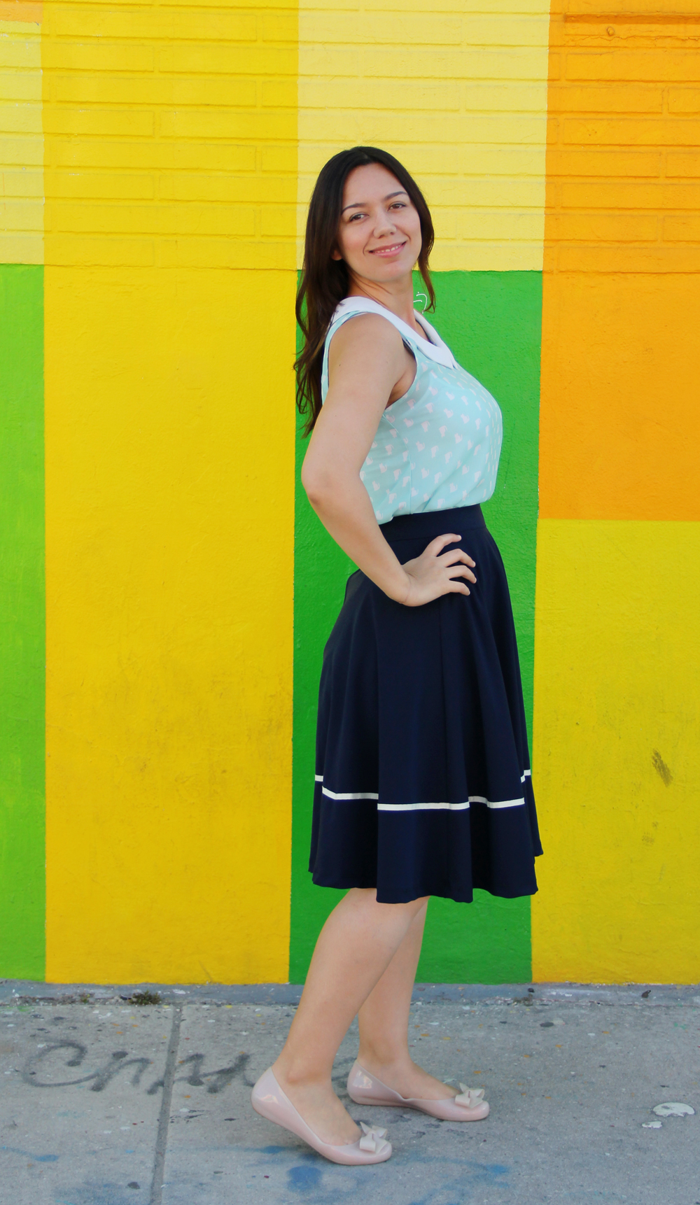 Cat patterned peter pan collar top with navy midi skirt and nude ballet flats.