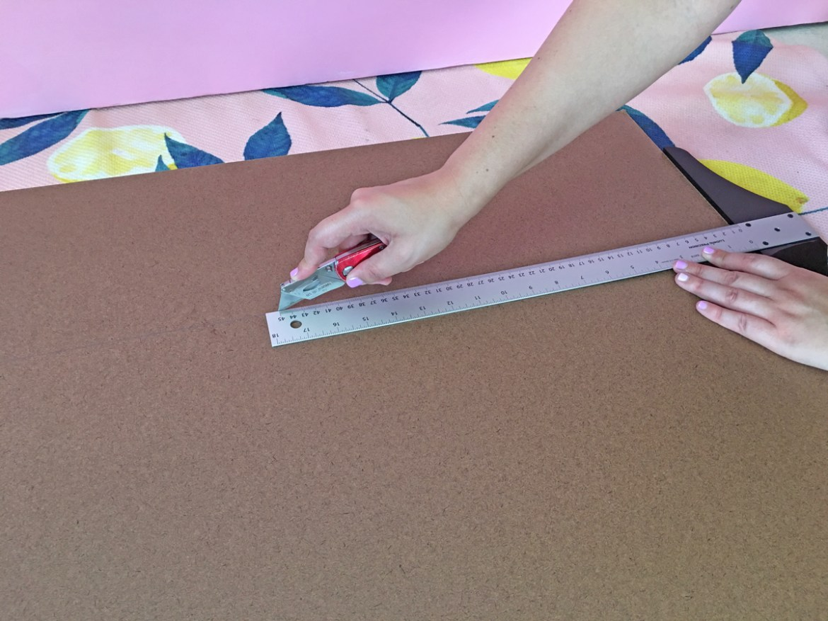 How to build a dog ramp tutorial - cut the hardboard with a razor knife into 15 inches wide by 48 inches long