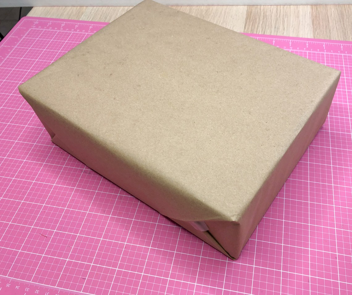 step 3: wrap your gift in kraft paper