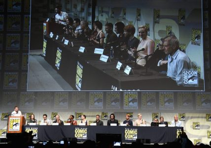 SAN DIEGO, CA - JULY 10: (L-R) Moderator Chris Hardwick, producer Kathleen Kennedy, director J.J. Abrams, screenwriter Lawrence Kasdan and actors John Boyega, Daisy Ridley, Oscar Isaac, Adam Driver, Domhnall Gleeson, Gwendoline Christie, Carrie Fisher, Mark Hamill and Harrison Ford at the Hall H Panel for `Star Wars: The Force Awakens` during Comic-Con International 2015 at the San Diego Convention Center on July 10, 2015 in San Diego, California. (Photo by Michael Buckner/Getty Images for Disney) *** Local Caption *** Chris Hardwick; Kathleen Kennedy; J.J. Abrams; Lawrence Kasdan; John Boyega; Daisy Ridley; Oscar Isaac; Adam Driver; Domhnall Gleeson; Gwendoline Christie; Carrie Fisher; Mark Hamill; Harrison Ford