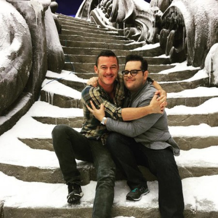 Josh Gad and Luke Evans embrace after Disney's Live-Action Beauty and the Beast wraps.