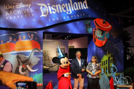 Walt Disney Company VP for Corporate Communications Adam Sanderson is joined by Becky Cline, and Sorcerer Mickey Mouse - Ribbon cutting ceremony of Disneyland The Exhibit at the D23 Expo