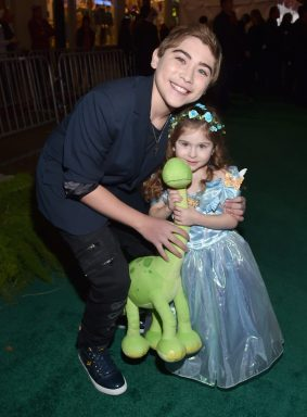 HOLLYWOOD, CA - NOVEMBER 17: (L-R) Actor Raymond Ochoa and guest attend the World Premiere Of Disney-Pixar's THE GOOD DINOSAUR at the El Capitan Theatre on November 17, 2015 in Hollywood, California. (Photo by Alberto E. Rodriguez/Getty Images for Disney) *** Local Caption *** Raymond Ochoa
