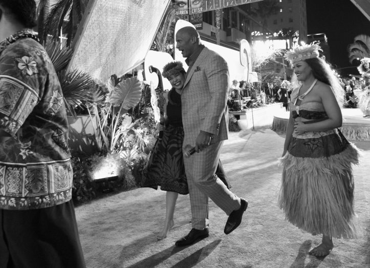 """HOLLYWOOD, CA - NOVEMBER 14: (EDITORS NOTE: Image has been shot in black and white. Color version not available.) Actors Auli'i Cravalho and Dwayne Johnson (both C) attend The World Premiere of Disney's """"MOANA"""" at the El Capitan Theatre on Monday, November 14, 2016 in Hollywood, CA. (Photo by Charley Gallay/Getty Images for Disney) *** Local Caption *** Auli'i Cravalho; Dwayne Johnson"""