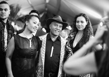 """HOLLYWOOD, CA - NOVEMBER 14: (EDITORS NOTE: Image has been shot in black and white. Color version not available.) Musicians Opetaia Foa'i (C) and Olivia Foa'i (R) with Te Vaka attend The World Premiere of Disney's """"MOANA"""" at the El Capitan Theatre on Monday, November 14, 2016 in Hollywood, CA. (Photo by Charley Gallay/Getty Images for Disney) *** Local Caption *** Opetaia Foa'i; Olivia Foa'i"""