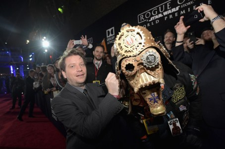 "HOLLYWOOD, CA - DECEMBER 10: Director Gareth Edwards (L) signs Christopher ""Dude Vader"" Canole's helmet at The World Premiere of Lucasfilm's highly anticipated, first-ever, standalone Star Wars adventure, ""Rogue One: A Star Wars Story"" at the Pantages Theatre on December 10, 2016 in Hollywood, California. (Photo by Charley Gallay/Getty Images for Disney) *** Local Caption *** Gareth Edwards; Christopher Canole"