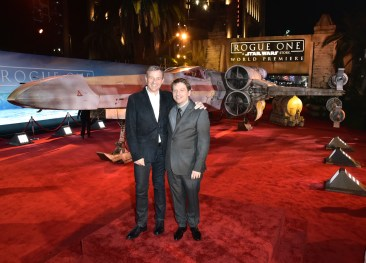 "HOLLYWOOD, CA - DECEMBER 10: The Walt Disney Company Chairman and CEO Bob Iger (L) and Director Gareth Edwards attend The World Premiere of Lucasfilm's highly anticipated, first-ever, standalone Star Wars adventure, ""Rogue One: A Star Wars Story"" at the Pantages Theatre on December 10, 2016 in Hollywood, California. (Photo by Marc Flores/Getty Images for Disney) *** Local Caption *** Bob Iger; Gareth Edwards"