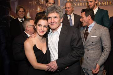 """Emma Watson and Alan Horn arrive for the world premiere of Disney's live-action """"Beauty and the Beast"""" at the El Capitan Theatre in Hollywood as the cast and filmmakers continue their worldwide publicity tour. .(Photo: Alex J. Berliner/ABImages)"""