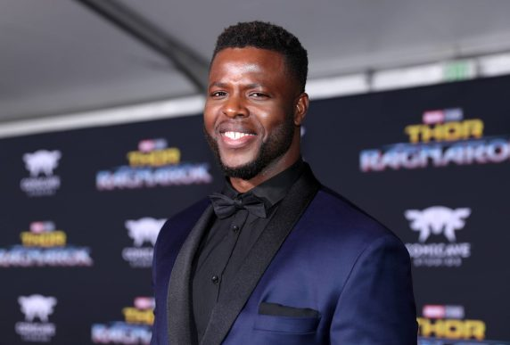 """HOLLYWOOD, CA - OCTOBER 10: Actor Winston Duke at The World Premiere of Marvel Studios' """"Thor: Ragnarok"""" at the El Capitan Theatre on October 10, 2017 in Hollywood, California. (Photo by Rich Polk/Getty Images for Disney) *** Local Caption *** Winston Duke"""