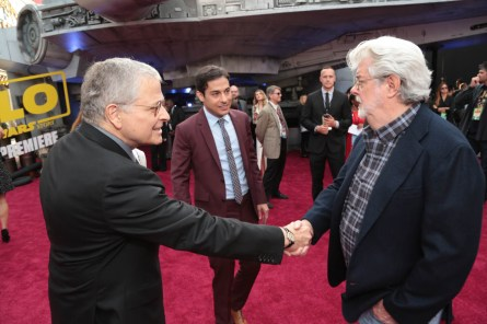 "Lawrence Kasdan and Jonathan Kasdan greet George Lucas at the world premiere of ""Solo: A Star Wars Story"" in Hollywood on May 10, 2018. (Photo: Alex J. Berliner/ABImages)"