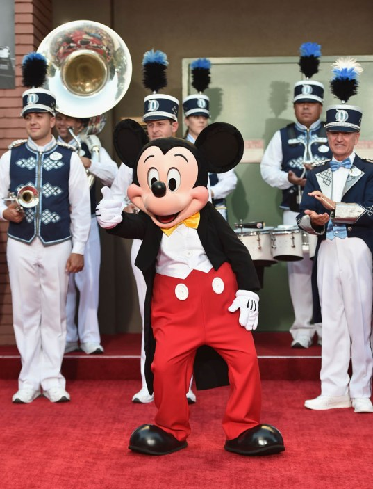 BURBANK, CA - JULY 30: Mickey Mouse and the Disneyland Band attend the dedication and re-naming of the historic Orchestra Stage, now the Sherman Brothers Stage A, on the Disney Burbank lot prior to the world premiere of Disney's 'Christopher Robin' at the studio's Main Theater, on July 30, 2018. (Photo by Alberto E. Rodriguez/Getty Images for Disney) *** Local Caption *** Mickey Mouse; Disneyland Band