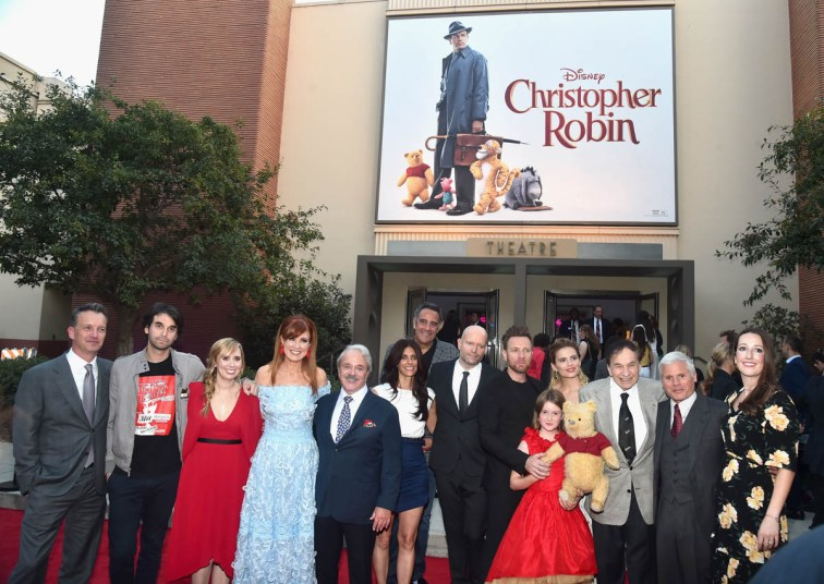 BURBANK, CA - JULY 30: (L-R) President of Walt Disney Studios Motion Picture Production, Sean Bailey, screenwriters Alex Ross Perry, Allison Schroeder, producer Kristin Burr, actor Jim Cummings, executive producer Renee Wolfe, actor Brad Garrett, director Marc Forster, actors Ewan McGregor, Bronte Carmichael, Hayley Atwell, songwriter Richard M. Sherman, producer Brigham Taylor and VP production at Walt Disney Pictures, Jessica Virtue attend the world premiere of Disney's 'Christopher Robin' at the Main Theater on the Walt Disney Studios lot in Burbank, CA on July 30, 2018. (Photo by Alberto E. Rodriguez/Getty Images for Disney) *** Local Caption *** Sean Bailey; Alex Ross Perry; Allison Schroeder; Kristin Burr; Jim Cummings; Renee Wolfe; Brad Garrett; Marc Forster; Ewan McGregor; Bronte Carmichael; Hayley Atwell; Richard M. Sherman; Brigham Taylor; Jessica Virtue