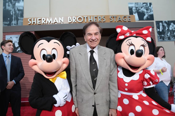 """Mickey Mouse and Richard M. Sherman and Minnie Mouse pose together at the dedication and re-naming of the historic Orchestra Stage, now the Sherman Brothers Stage A, on the Disney Burbank lot prior to the world premiere of Disney's """"Christopher Robin"""" at the studio's Main Theater, on July 30, 2018 in Burbank, CA (Photo: Alex J. Berliner/ABImages)"""
