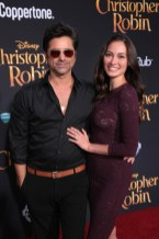 """John Stamos and Caitlin McHugh attend the world premiere of Disney's """"Christopher Robin"""" at the Main Theater on the Walt Disney Studios lot in Burbank, CA on July 30, 2018. (Photo: Alex J. Berliner/ABImages)"""