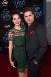 HOLLYWOOD, CA - NOVEMBER 29: Caitlin McHugh (L) and John Stamos attend Disney's 'Mary Poppins Returns' World Premiere at the Dolby Theatre on November 29, 2018 in Hollywood, California. (Photo by Alberto E. Rodriguez/Getty Images for Disney) *** Local Caption *** Caitlin McHugh; John Stamos