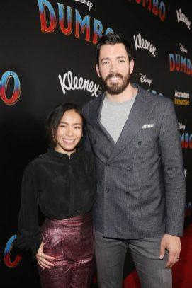 """LOS ANGELES, CA - MARCH 11: Drew Scott. (R) and Linda Phan attend the World Premiere of Disney's """"Dumbo"""" at the El Capitan Theatre on March 11, 2019 in Los Angeles, California. (Photo by Jesse Grant/Getty Images for Disney) *** Local Caption *** Linda Phan; Drew Scott"""