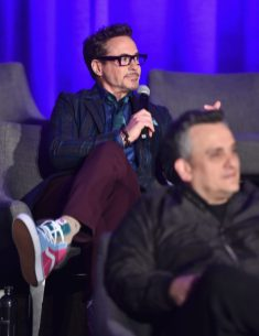 """LOS ANGELES, CA - APRIL 07: Robert Downey Jr. (back) and Director Joe Russo speak onstage during Marvel Studios' """"Avengers: Endgame"""" Global Junket Press Conference at the InterContinental Los Angeles Downtown on April 7, 2019 in Los Angeles, California. (Photo by Alberto E. Rodriguez/Getty Images for Disney) *** Local Caption *** Robert Downey Jr.; Joe Russo"""