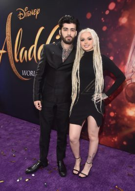 "LOS ANGELES, CA - MAY 21: ZAYN (L) and Zhavia Ward attend the World Premiere of Disney's ""Aladdin"" at the El Capitan Theater in Hollywood CA on May 21, 2019, in the culmination of the film's Magic Carpet World Tour with stops in Paris, London, Berlin, Tokyo, Mexico City and Amman, Jordan. (Photo by Alberto E. Rodriguez/Getty Images for Disney) *** Local Caption *** ZAYN; Zhavia Ward"