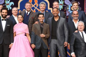"LOS ANGELES, CA - MAY 21: (L-R front) Actors Marwan Kenzari, Naomi Scott, Mena Massoud, Will Smith, Navid Negahban and Composer Alan Menken . (L-R back) Walt Disney Studios President, Alan Bergman, Director Guy Ritchie, Chairman, The Walt Disney Studios, Alan Horn, President of Walt Disney Studios Motion Picture Production, Sean Bailey and producer Jonathan Eirich attend the World Premiere of Disney's ""Aladdin"" at the El Capitan Theater in Hollywood CA on May 21, 2019, in the culmination of the film's Magic Carpet World Tour with stops in Paris, London, Berlin, Tokyo, Mexico City and Amman, Jordan. (Photo by Jesse Grant/Getty Images for Disney) *** Local Caption *** Marwan Kenzari; Naomi Scott; Mena Massoud; Will Smith; Navid Negahban; Alan Menken; Alan Bergman; Guy Ritchie; Alan Horn; Sean Bailey; Jonathan EirichJonathan Eirich"