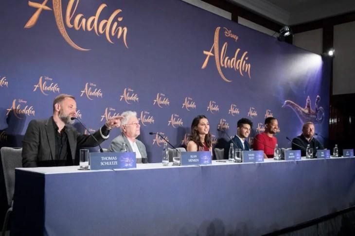 "(L-R) Thomas Schulze, Alan Menken, Naomi Scott, Mena Massoud, Will Smith and Guy Ritchie attend the ""Aladdin"" press conference on May 11, 2019 in Berlin, Germany. .© Disney/Folioscope/Hanna Boussouar"