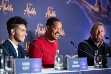 """(L-R) Mena Massoud, Will Smith and Guy Ritchie attend the """"Aladdin"""" press conference on May 11, 2019 in Berlin, Germany. .© Disney/Folioscope/Hanna Boussouar"""
