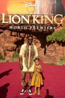 """HOLLYWOOD, CALIFORNIA - JULY 09: Lance Gross (L) and Berkeley Brynn Gross attend the World Premiere of Disney's """"THE LION KING"""" at the Dolby Theatre on July 09, 2019 in Hollywood, California. (Photo by Alberto E. Rodriguez/Getty Images for Disney)"""
