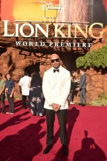 """HOLLYWOOD, CALIFORNIA - JULY 09: Sir John attends the World Premiere of Disney's """"THE LION KING"""" at the Dolby Theatre on July 09, 2019 in Hollywood, California. (Photo by Alberto E. Rodriguez/Getty Images for Disney)"""