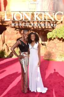 """HOLLYWOOD, CALIFORNIA - JULY 09: Florence Kasumba (L) and Shahadi Wright Joseph attend the World Premiere of Disney's """"THE LION KING"""" at the Dolby Theatre on July 09, 2019 in Hollywood, California. (Photo by Alberto E. Rodriguez/Getty Images for Disney)"""