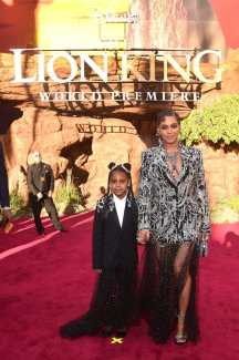 """HOLLYWOOD, CALIFORNIA - JULY 09: Blue Ivy Carter (L) and Beyonce Knowles-Carter attend the World Premiere of Disney's """"THE LION KING"""" at the Dolby Theatre on July 09, 2019 in Hollywood, California. (Photo by Alberto E. Rodriguez/Getty Images for Disney)"""