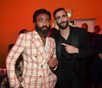 """HOLLYWOOD, CALIFORNIA - JULY 09: Donald Glover (L) and Marco Mengoni attend the World Premiere of Disney's """"THE LION KING"""" at the Dolby Theatre on July 09, 2019 in Hollywood, California. (Photo by Alberto E. Rodriguez/Getty Images for Disney)"""