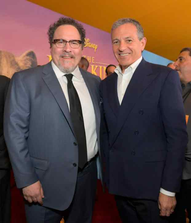 """HOLLYWOOD, CALIFORNIA - JULY 09: Director/producer Jon Favreau and The Walt Disney Company Chairman and CEO Bob Iger attend the World Premiere of Disney's """"THE LION KING"""" at the Dolby Theatre on July 09, 2019 in Hollywood, California. (Photo by Charley Gallay/Getty Images for Disney)"""