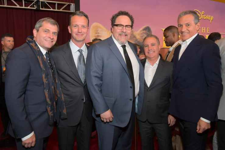 """HOLLYWOOD, CALIFORNIA - JULY 09: (L-R) Sam Dickerman, President of Walt Disney Studios Motion Picture Production Sean Bailey, Director/Producer Jon Favreau, Co-Chairman of The Walt Disney Studios Alan Bergman, and The Walt Disney Company Chairman and CEO Bob Iger attend the World Premiere of Disney's """"THE LION KING"""" at the Dolby Theatre on July 09, 2019 in Hollywood, California. (Photo by Charley Gallay/Getty Images for Disney)"""