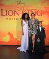 """HOLLYWOOD, CALIFORNIA - JULY 09: (L-R) Shahadi Wright Joseph, Beyonce Knowles-Carter, and Blue Ivy Carter attend the World Premiere of Disney's """"THE LION KING"""" at the Dolby Theatre on July 09, 2019 in Hollywood, California. (Photo by Charley Gallay/Getty Images for Disney)"""