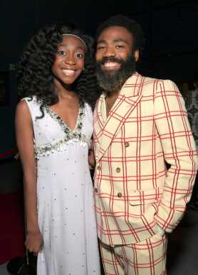 """HOLLYWOOD, CALIFORNIA - JULY 09: Shahadi Wright Joseph and Donald Glover attend the World Premiere of Disney's """"THE LION KING"""" at the Dolby Theatre on July 09, 2019 in Hollywood, California. (Photo by Charley Gallay/Getty Images for Disney)"""
