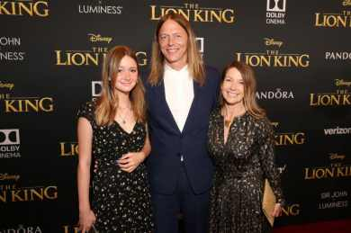 """HOLLYWOOD, CALIFORNIA - JULY 09: James Chinlund (C) and Clare Crespo Chinlund (R) attend the World Premiere of Disney's """"THE LION KING"""" at the Dolby Theatre on July 09, 2019 in Hollywood, California. (Photo by Jesse Grant/Getty Images for Disney)"""