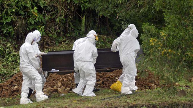 Ilustrasi pemakaman jenazah covid (Foto: CNNIndonesia)