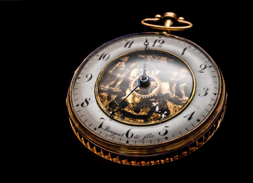 An image of an antique gold pocket watch